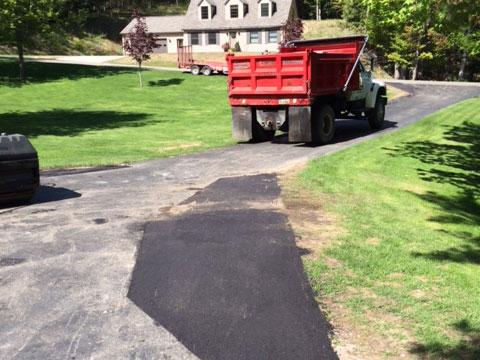 sealcoating asphalt driveway repair cadillac michigan wexford county