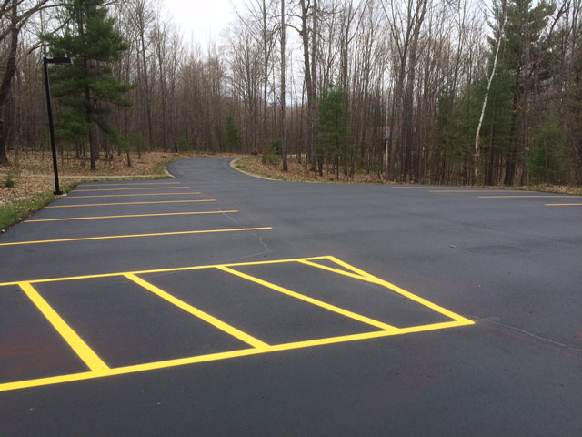 parking lot blacktop seal coating and striping services by brian's superior sealcoating in Manistee County michigan