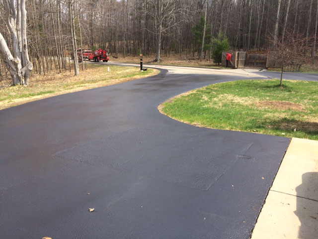 asphalt sealcoating end of driveway residential sealcoating ludington pentwater hart michigan mason county